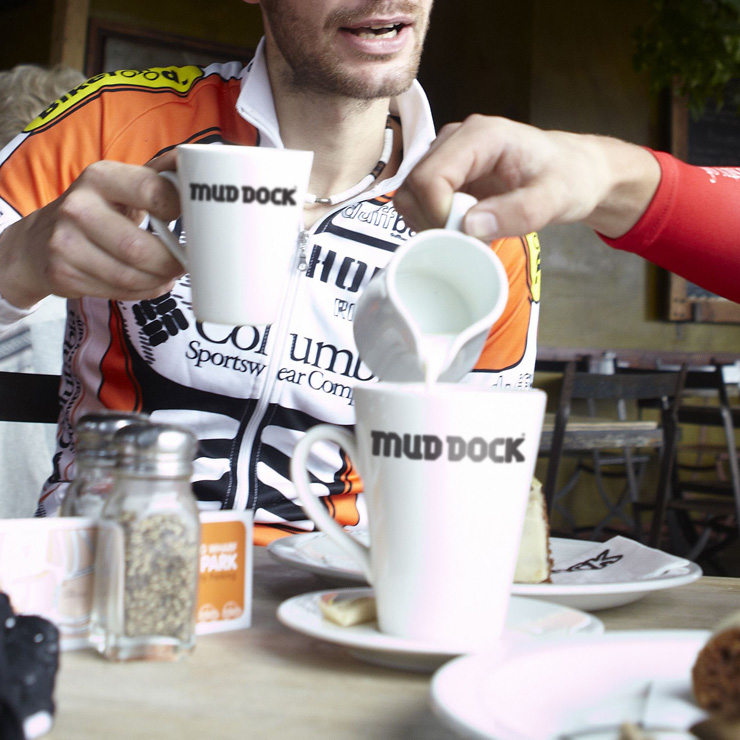 Cyclists enjoying coffee at Mud Dock